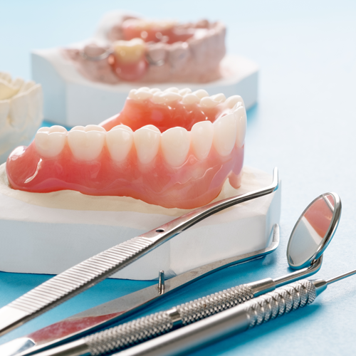 Dentures with dentists tools for denture repair