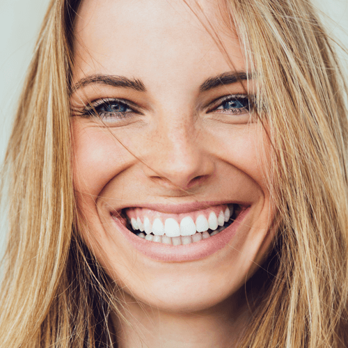 Happy young women with natural looking dentures