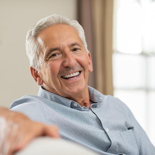 Smiling man wearing dentures