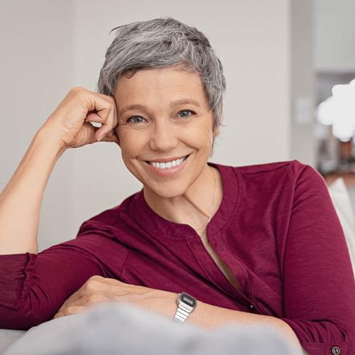 Smiling senior wearing natural looking white dentures