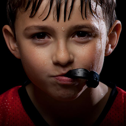 Child wearing protective sports mouthguard