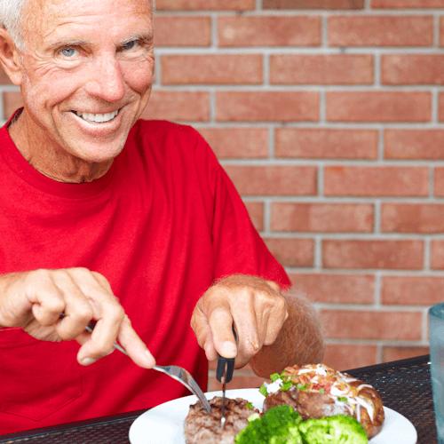 Man eating a steak